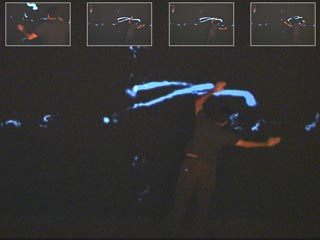 visitor creating light traces with body motion